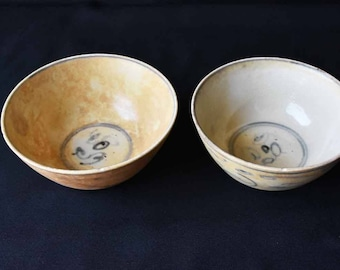 Two very old ceramic bowls