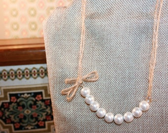 Shabby chic pearl and bow necklace