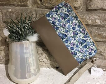 Faux leather clutch with blue flowers