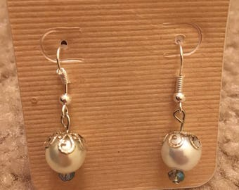 Capped leafy pearl blue bead on bottom dangling earrings