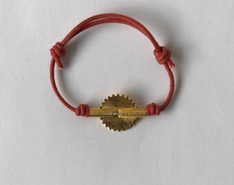 Red cord bracelet with a vermeil bead.