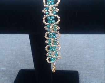 Elegant teal and gold bracelet