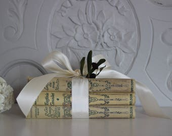 French books covered with fabric, old books .