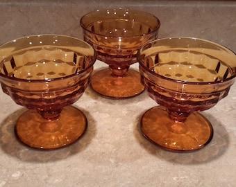 3 amber dessert dishes