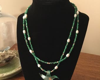 "Handmade 20"" necklace with aqua glass beads, freshwater pearls, and sunburst pendant"