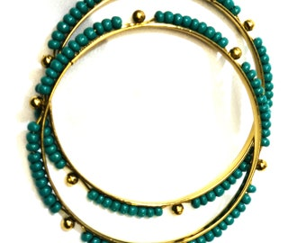 A pair of Antique bead bangles