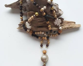 With boho chic tassel necklace