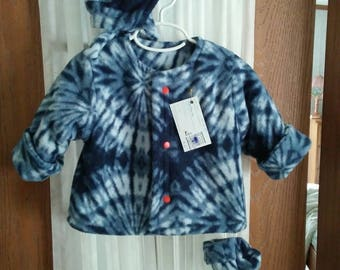 Jacket 12 to 18 month blue & white fleece. Red snap front. Matching hat with over ear panel,  double tie. Thumbless mittens. Items lined.