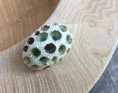 Green-brown starburst coral porcelain brooch