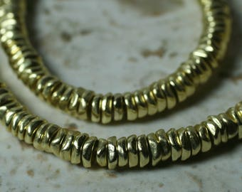 Gold tone mini chip rodelle beads aprox 4-5mm in diameter 2mm thick hole size aprox 1.5mm, 12 pcs (item ID FA2603MB)