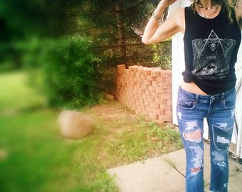 Cropped distressed patched jeans