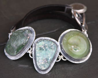 ancient roman glass/coin, leather, and sterling silver metalwork link toggle bracelet