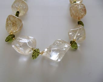 CB 204 Necklace has large citrine glass nuggets and glass peridot leaves.