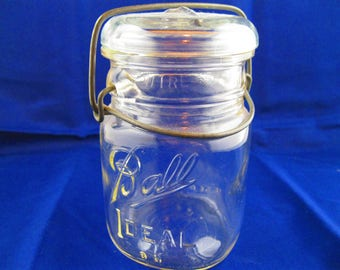 Ball Ideal canning jar.  Pint size with glass lid and wire closure.