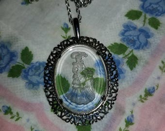 Vintage Avon lady with parasol cameo necklace.