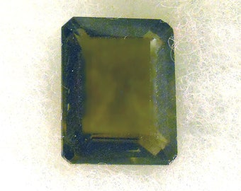 26.5 CT  ....  Faceted Smokey Quartz Gemstone ... 21 x 17 x 10 MM