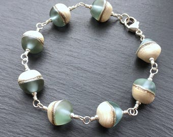 Cream and blue-green frosted lampwork glass nugget beads and sterling silver 'Beach' bracelet handmade in the UK by Laura Sparling