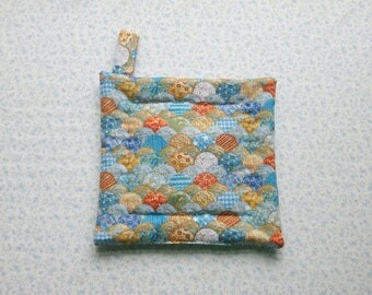 blue scalloped hand quilted insulated potholder with loop to hang