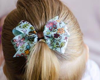 Hair Bow - Turquoise Flower Print Pinwheel Bow