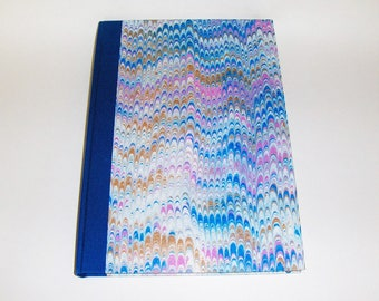 Marbled paper  book  travels. Hand bounded   cm 17 x 24 cm.  1006