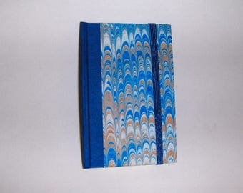 Marbled paper  address book with elastic . Hand bounded Florentine style -   cm 8 x cm 6.  1024
