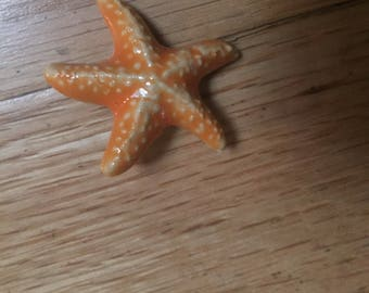 Sweet tangerine orange ceramic starfish pin