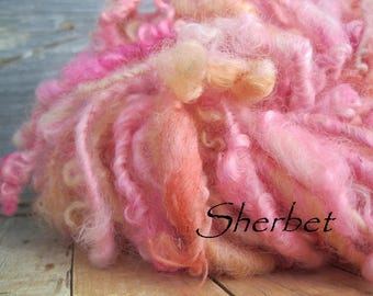 Hand spun curly lock spun yarn all wool shades of pink and soft peach extra bulky chunky trim doll hair