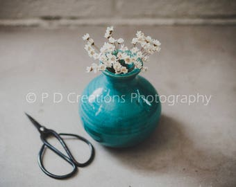 Small White Flowers in Turquoise Vase