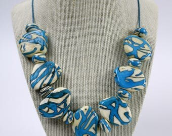 Ivory and Blue Swirl Necklace
