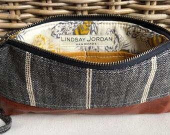 Black and off-white LINEN & dark brown sheepskin LEATHER  wristlet pouch: pumpkin gold pockets | blue, pink, gray and gold bees lining