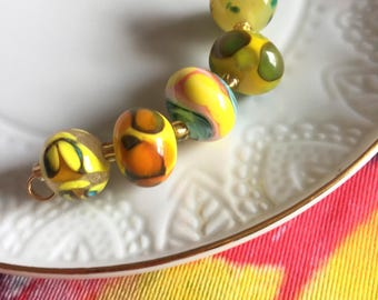 Set of 5 Handcrafted Lampwork Glass Art Beads in beautiful summer palette shades of yellows, green, orange, teal and turquoise.