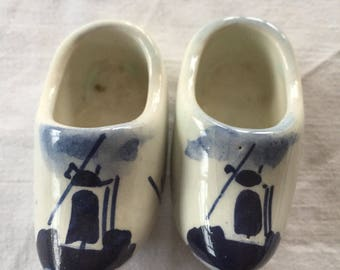 A pair of vintage small ceramic Delft clogs, souvenir of Holland.