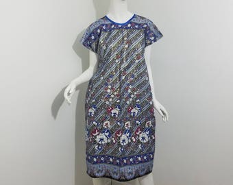 Dolman sleeved African Print dress- Gold, blue, maroon floral pattern with blue trim (size: US 6-8)