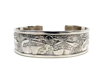 Relios Sterling Silver Storyteller Cuff Bracelet by Roderick Tenorio