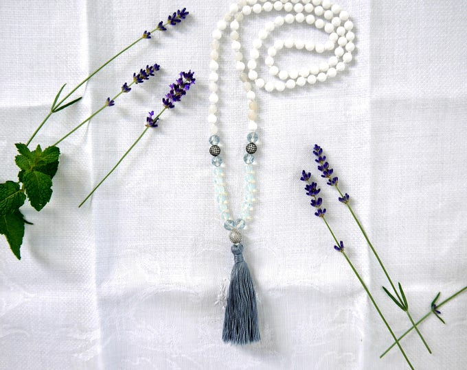 handknotted tassel necklace with white jade beads, grey agate beads, opal beads, light blue czech glass beads and cubic zirkonia beads, mala