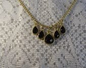 """Vintage 18 inch Signed """"BR"""" Bib Necklace With 5 Beautiful Faceted Black Teardrops in Soft Gold Cabochons, Attached to a Soft Gold Chain"""