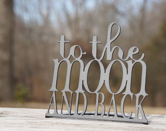 To The Moon and Back Word Stand