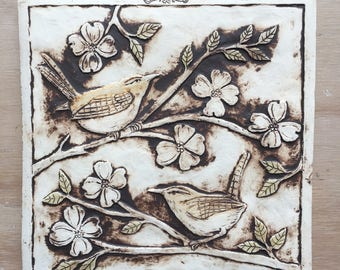 Handmade ceramic bird tile in brown and light olive