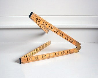 antique folding wooden ruler tool