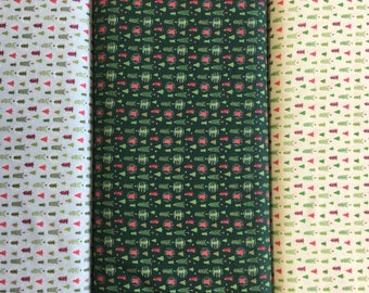 FabricFreedom Festive Friends Collection FF304 by the half metre in green, cream and blue