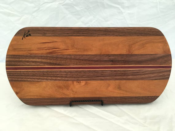 Cheese board made from cherry, maple, walnut and purple heart woods