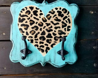 Adorable turquoise and cheetah hook wall hanger