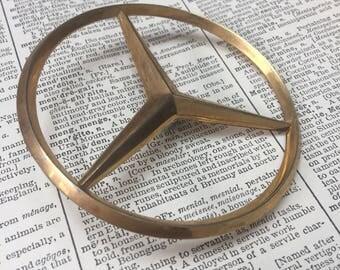 Vintage mercedes benz gold hood ornament - metal sports car auto emblem - vintage metal car badge -