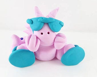 Clay pink dragon with flip flops and sunglasses