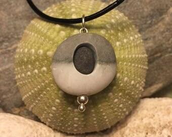 Beach stone jewelry- beach stone necklace with a beachstone inside