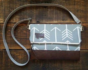 Gray with white arrow print/Montana Patch/Foldover Crossbody/Dark brown vegan leather/White zipper/Gray linen strap