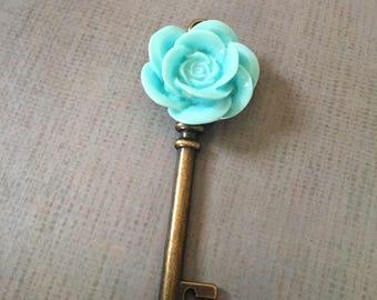 Bronze tone skeleton key charm charm with blue cabochon