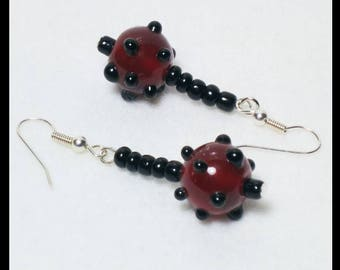 Dangle earrings - deep crimson glass beads with black spots.  Lamp-work beads.  Black and Red.  One of a kind. Handmade. Matching Necklace