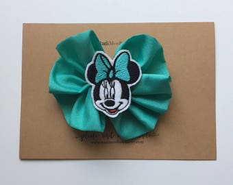 Adorable Minnie Mouse clip wrapped in ribbon.MINNIE mouse, minnie clip disney