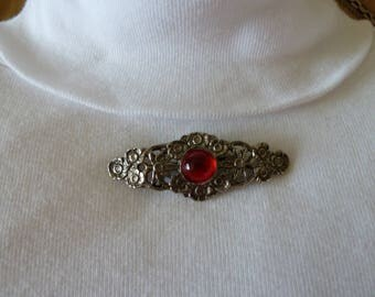 Brooch, Pin, Antique Pin in a Silver floral design with a Ruby Red Center.